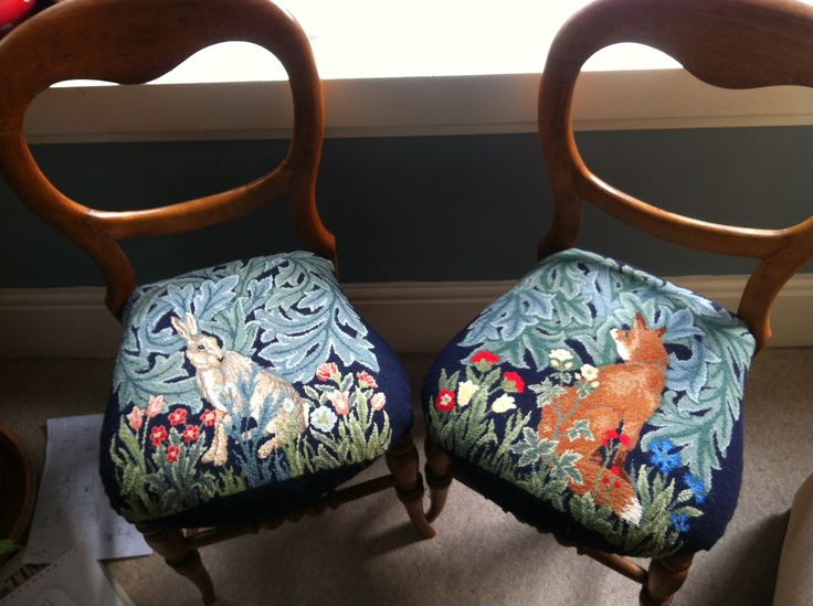 A pair of chairs upholstered with the Fox and Hare needlepoint kits