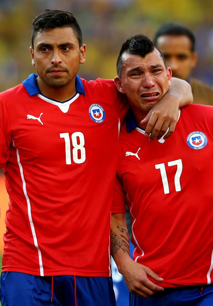 BELO HORIZONTE, BRAZIL - JUNE 28: Gonzalo Jara (L) and Gary Medel of Chile react after being defeated by Brazil in a penalty shootout during the 2014 FIFA World Cup Brazil round of 16 match between Brazil and Chile at Estadio Mineirao on June 28, 2014 in Belo Horizonte, Brazil. (Photo by Quinn Rooney/Getty Images)