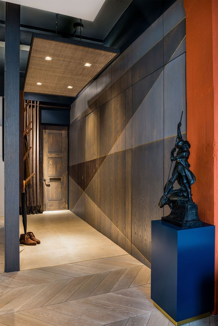 Modern hallway design with untreated wooden flooring and angular wood panels - The Rovers Return Luxury interior designs by Daniel Hopwood and Studio Hopwood. Designs featuring on the Martyn White Designs Blog