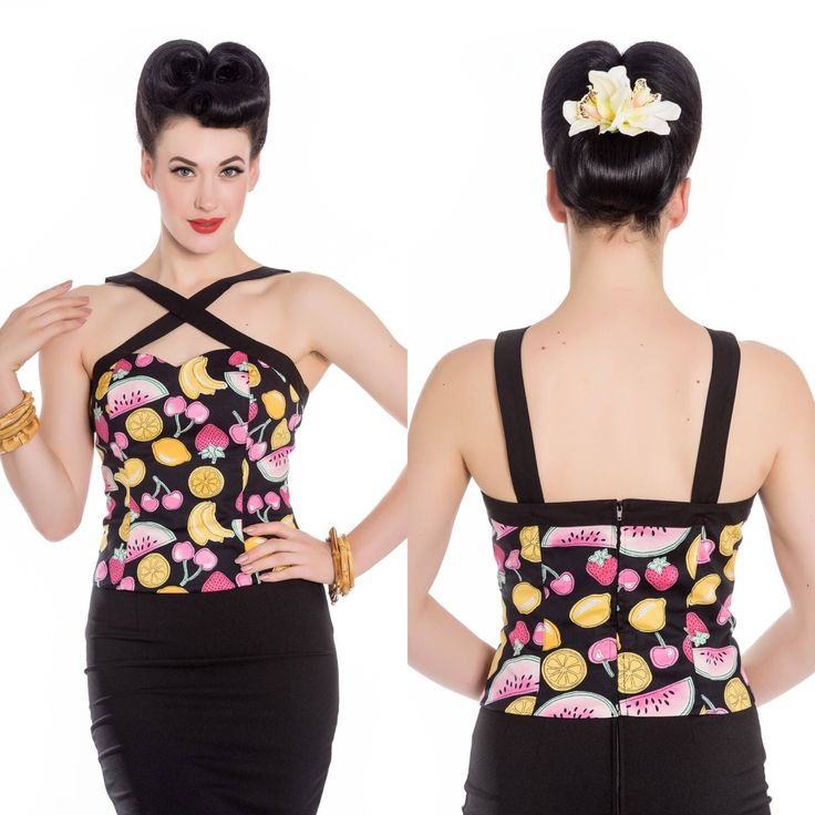The Stella Top in Tutti Frutti Print.    DESCRIPTION   Printed top. Print is of lemons, cherries, strawberries, oranges and slices of melon on a black background. Sweetheart neckline. 2 black straps that crossover at the front. Bust seams. Zip in the centre back to fasten. Seams on the back seam. Fabric content: 98% Cotton 2% Elastane.