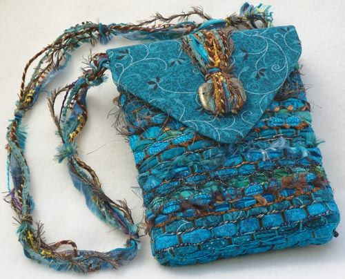 Nancy Faris Fiber Artist; Turquoise prints of all shades and depths, woven togeather with brown, copper and bronze textile fibers and yarns. To buy.