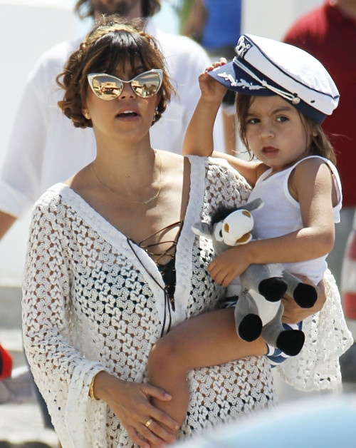 Mom-of-two Kourtney Kardashian was photographed carrying her 3-year-old son Mason in Santorini, Greece on Monday (April 29). While boarding a catamaran boat, the reality star was seen toting her preschooler who wore a cute captain hat.    Joined by longtime boyfriend Scott Disick and their 9-month-old daughter Penelope, Kourtney and the kids are currently vacationing with her famous family.