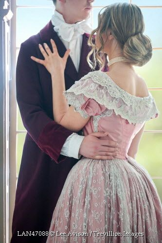 Trevillion Images - historical-couple-embracing-by-window