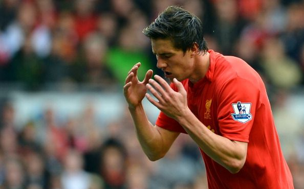 Liverpool's English defender Martin Kelly reacts during the English Premier League football match between Liverpool and Manchester United at Anfield in Liverpool, north-west England on September 23, 2012