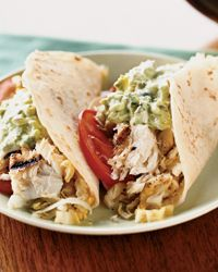 Fish Tacos with Creamy Lime Guacamole and Cabbage Slaw.