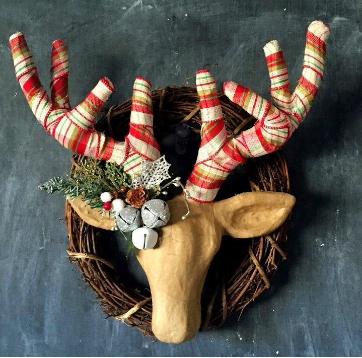 Love this DIY wreath from @craftomanic - Glue ribbon around the antlers of a paper mache deer head and decorate. Attach the deer head to a grapevine wreath.