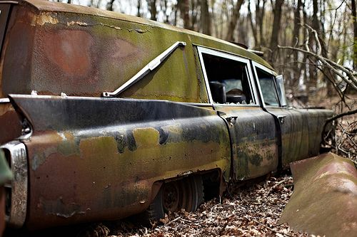 Rusted hearse.