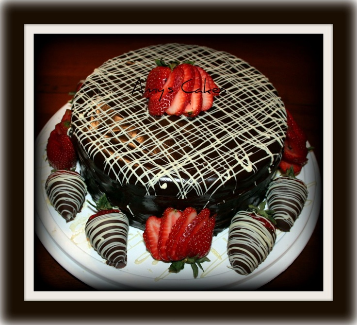 Chocolate Chocolate Pudding Ganache Cake with Dark and White chocolate drizzle and dipped strawberries.