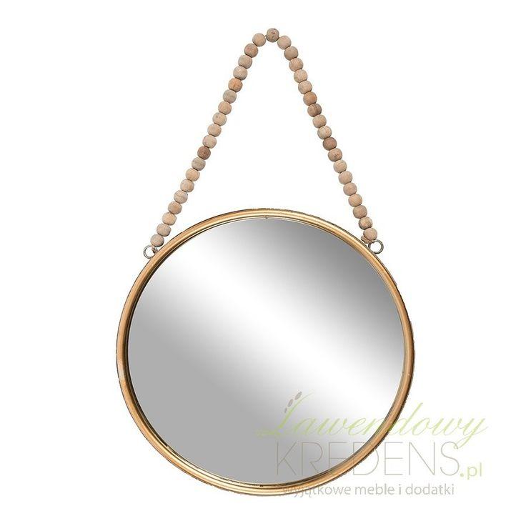 Okrągłe prowansalskie lustro Belldeco ze złotą ramą. Posiada sznurek do powieszenia zrobiony z koralików.
