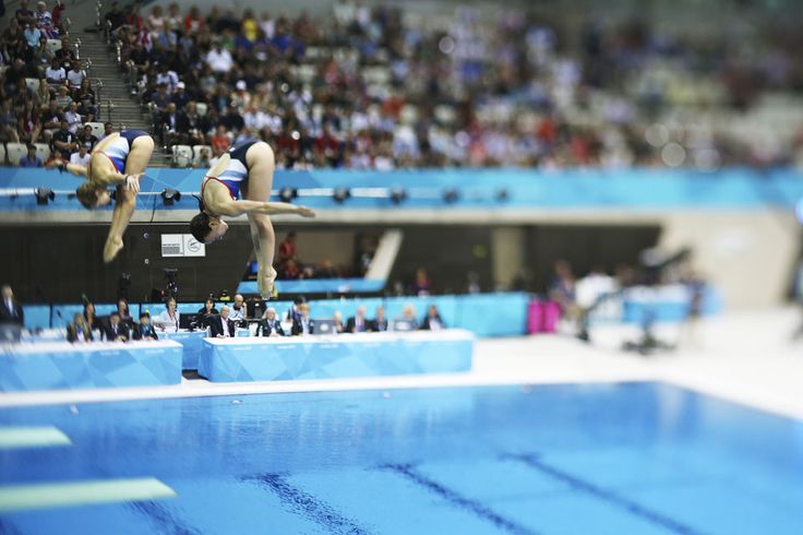 A spectacular shot of Team GB divers Rebecca Gallantree and Alicia Blagg in the women's synchronised 3m springboard final on Day 2 of the London 2012 Olympic Games at the Aquatics Centre.  IOC/John Huet