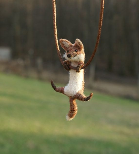 Heres another fox! This one is sculpted using the process of needle felting...forming wool using large barbed needles. He has embroidered features