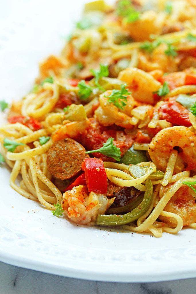 Cajun Shrimp Pasta. Omit shrimp and try using tofurkey andoulle sausage, veggie creamer and vutter. Looks yummy and really easy to veggify.