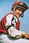 Julie Krone (1963-) is the first female jockey to win a Triple Crown race, doing it on Colonial Affair in the 1993 Belmont Stakes. She is the Big Sport of Turfdom winner from 1988 and in 1994 won the ESPY Award for Best Female Athlete. In a career spanning 1981-2004, she had 21,411 mounts, 3,704 wins and a winning percentage of 17.3%. Some of the horses she helmed were Candy Ride, Colonial Affair, Da Hoss, Halfbridled, Peaks And Valleys, Royal Mountain Inn, Sweet Return, Safely Kept…