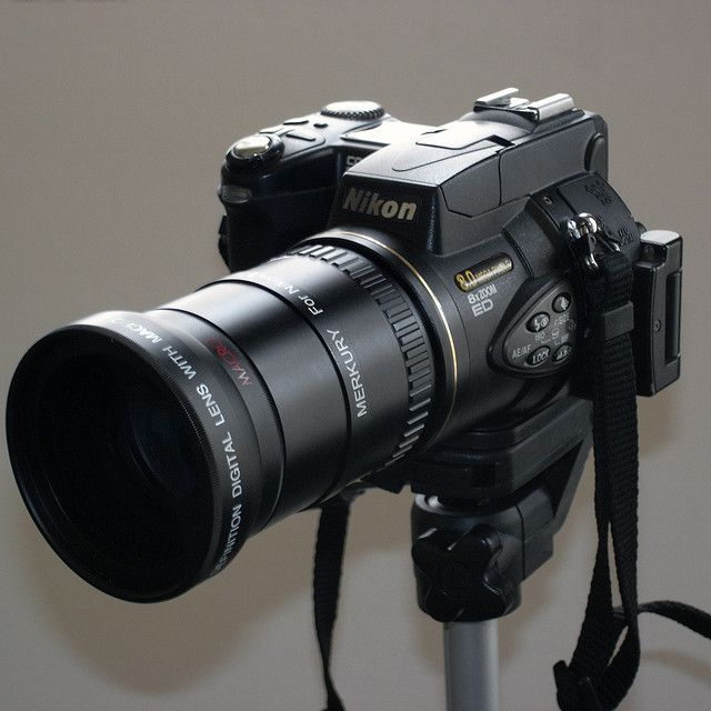 Nikon Coolpix 8700 Camera with telephoto adapter lens.     These are the top brand (nikon digital Camera| sony digital camera| canon digital camera| digital camera srl)