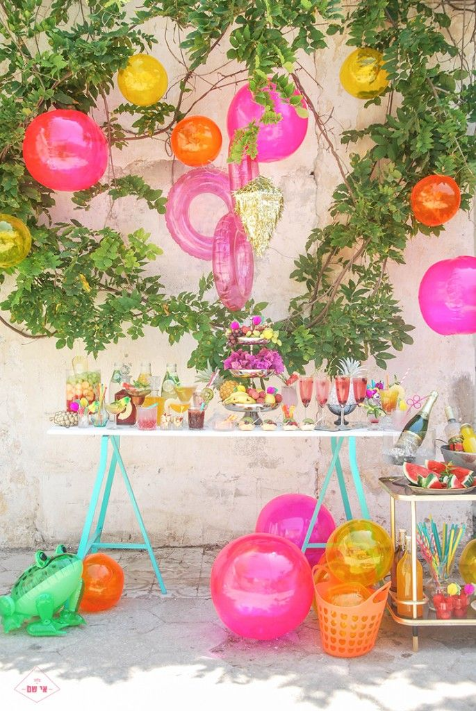 Pool toys as brightly colored party decorations. What a great idea. Spray paint them to be less neon and more seasonal.