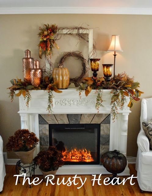 Rusty Heart Designs. Layered use of old frame, grapevine, fall flowers on a mantel.