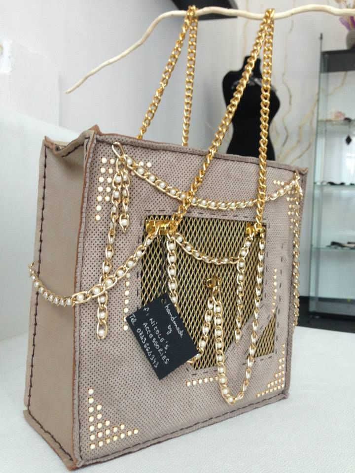 Have you ever wondered how a steel mesh bag would look like? Well..you have right here:beige leather handmade bag, accessorized with golden details and pearls chain #handmade #statement #bag #nicole  For prices in euro, leave a message!