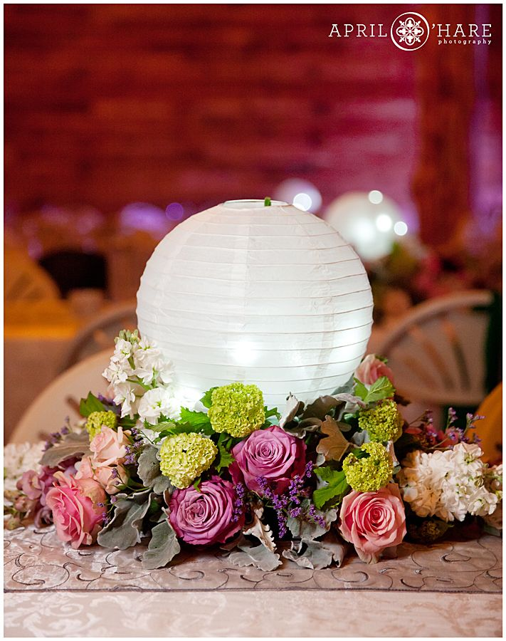 paper lantern table centerpieces | The white paper lantern table centerpieces lit up inside a barn ...