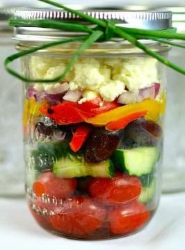 13 colorful, healthy salads in a mason jar! Mediterranean salad in a jar: cherry tomatoes, peppers, cucumbers, avocado, red onions, feta, olives  http://blog.rateyourburn.com/blog/post/2013/04/03/13-colorful-healthy-salads-in-a-mason-jar.aspx
