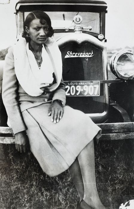 An African American woman sitting on car bumper, Shreveport, Louisiana, circa 1931. The Burns Archive