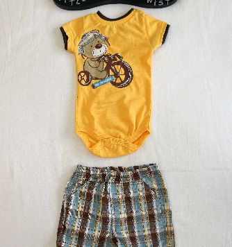 Bear onesie with shorts. Sizes 3-6months and 6-9months. NOW JUST $8