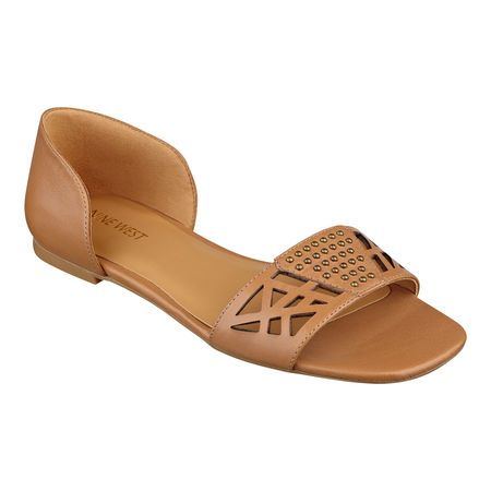"""Very studly. Our two-piece Slowdown peep toe flats are bespeckled with studs centered between geometric laser cutouts. Wear them with everything from skirts and dresses to Capris and shorts. They're going to be a season favorite. Leather upper. Man-made 1/4"""" sole. Imported."""