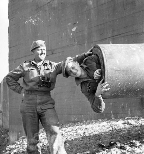 Canadian infantrymen of the North Shore Regiment examine a captured German cross-Channel gun, 1944 via reddit
