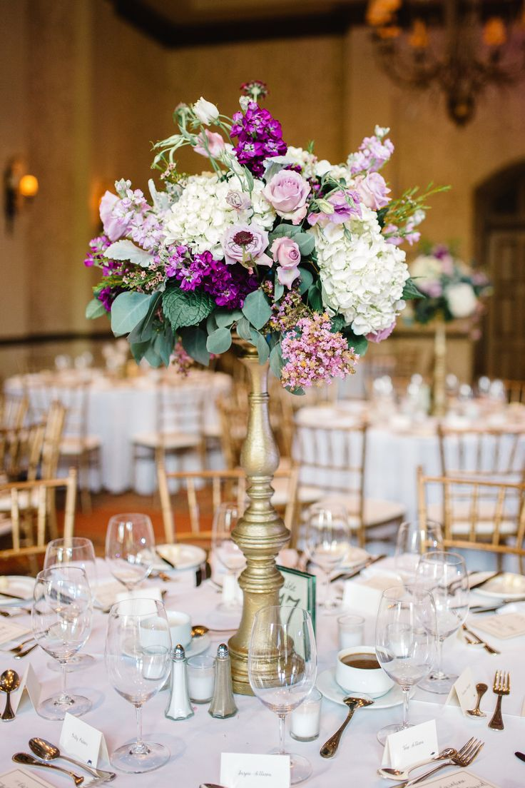 wedding reception centerpiece of white hydrangea, lavender