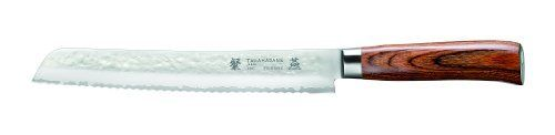 "Tamahagane San Tsubame Wood SNH-1118 - 9 inch, 230mm Bread Knife by Tamahagane. $199.95. The angle of the edge is 14 to15-Degree and 61-Degree on the rockwell scale for hardness. Dark laminated wood, hand hammered and sandblasted for a matte finish. Manufactured by Kataoka and Company in Niigata, Japan. 3-Ply stainless steel with VG-5 center and the outside layers of SUS410SS. The word Tamahagane means ""precious steel"". The Tamahagane San Tsubame hand-ha-mmere..."