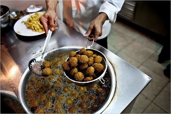 """Amman, Jordan """"A falafel vendor on Rainbow Street, which is the nexus of urban cool with art galleries, cafes and the fun Friday flea market called Jara Souk."""" Photo: Bryan Denton for The New York Times"""