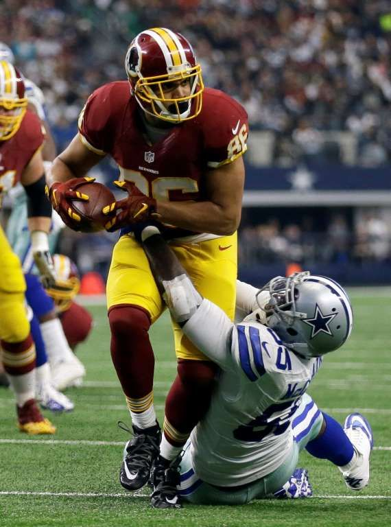 Washington Redskins tight end Jordan Reed (86) fights for extra yardage after catching a pass as Dallas Cowboys middle linebacker Rolando McClain (55) attempts the stop during an NFL football game, Sunday, Jan. 3, 2016, in Arlington, Texas.