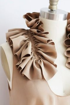 great idea. Just take a rectangular piece of fabric, add 2 rows of gathering stitches and create an impromptu collar.