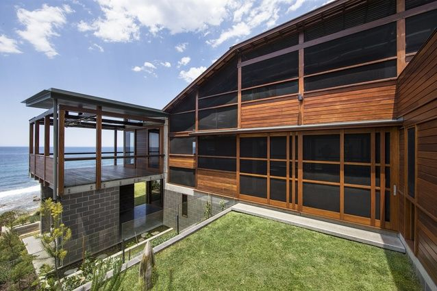 South Coast NSW House. The secure Northern screened triple height veranda act as the lungs of the house, allowing the house to be fully opened on warm nights to maximise cross ventilation from the ocean breeze.