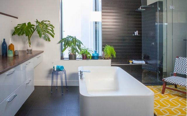 HOUSE FRIEDMAN On trend with our stylish rug from www.lundruggallery.co.za #plants #capetownbathrooms #avantagebath