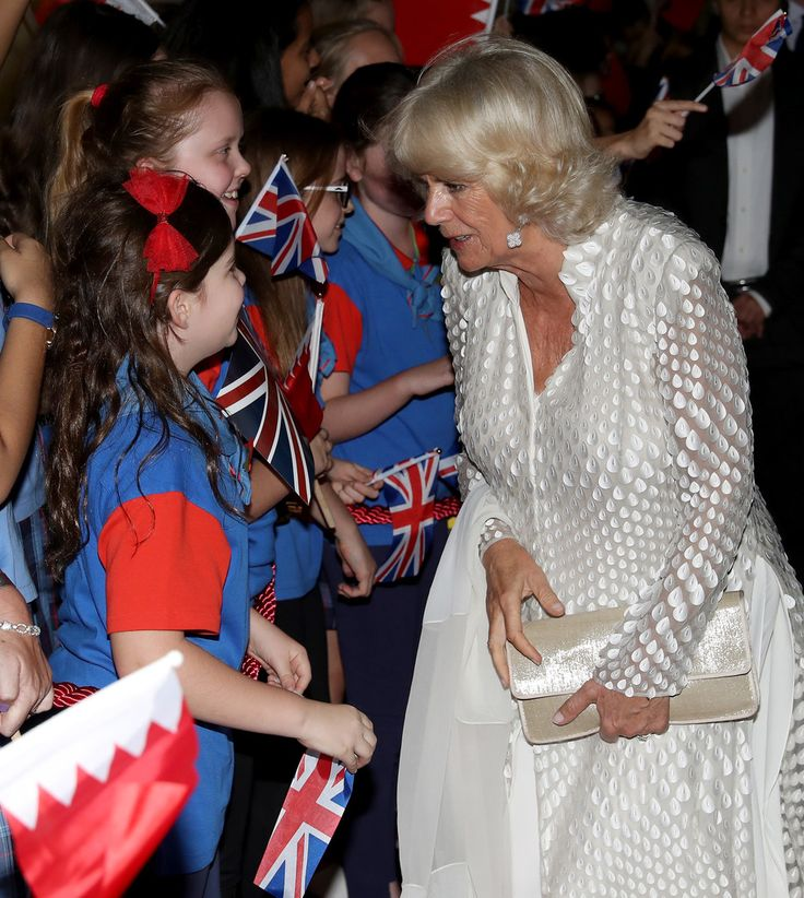 Camilla Parker Bowles Photos Photos - Camilla, Duchess of Cornwall is greeted by schoolchilden as she attends a reception at the British Embassy on November 10, 2016 in Manama, Bahrain. The Prince of Wales and the Duchess of Cornwall are on a Royal tour of the Middle East which began with Oman, the UAE and finally Bahrain. - The Prince of Wales and The Duchess of Cornwall Tour Bahrain - Day 3