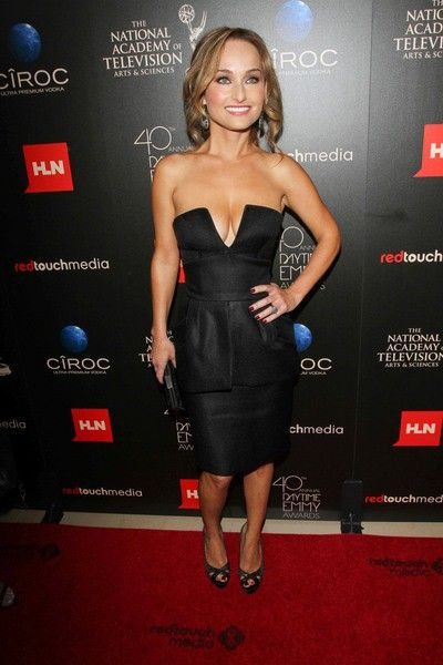 Giada De Laurentiis in a black dress with a plunging ...