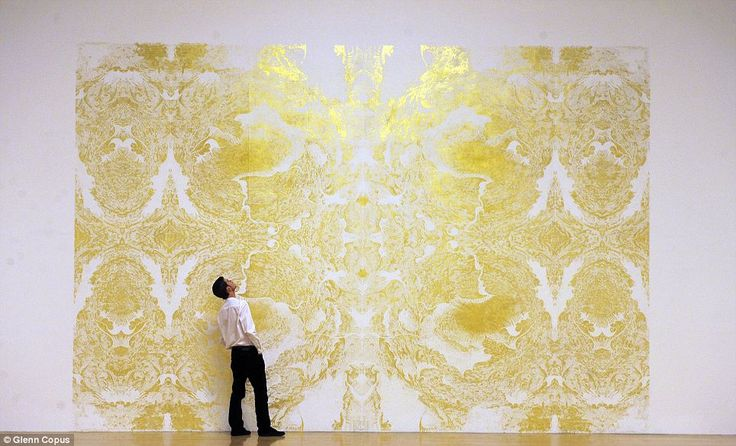 A visitor examines the restrained fresco by this year's Turner Prize winner Richard Wright