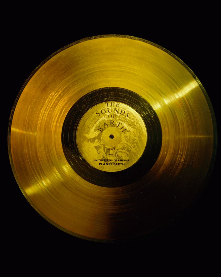 "Flying board Voyagers 1 and 2 are identical ""golden"" records, carrying the story of Earth far into deep space. The 12 inch gold-plated copper discs contain greetings in 60 languages, samples of music from different cultures and eras, and natural and man-made sounds from Earth. (Great Images in NASA)"