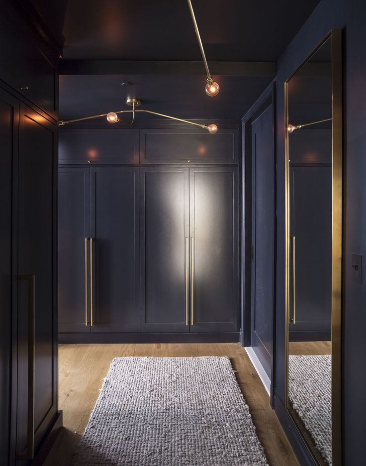 Midnight blue dressing room with brass detailing in an apartment designed by Workstead, Matthew Williams photo | Remodelista