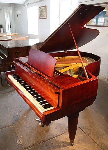 A 1955, Yamaha No20 grand piano with a satin, mahogany case. Piano features unusual, angular case styling. Piano lyre rests on a single rod. A rare collectable, vintage Yamaha at Besbrode Pianos