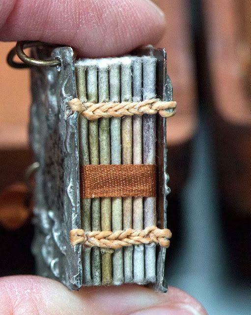 miniature metallic book : metal covers, coptic stitch, multi-coloured signatures. {Leslie Marsh}