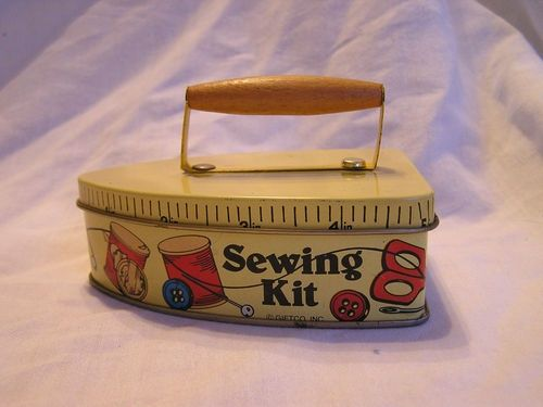 This is adorable, a sewing kit tin shaped like an iron.