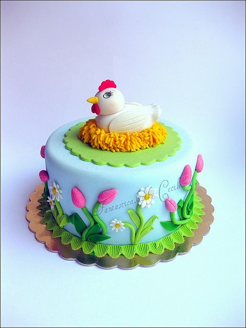 Easter cake...except for topper be bunny feet and tail...add picket fence around side with flowers maybe