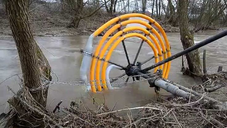 A water wheel uses the energy of flowing water to move the water through coiled pipe and as it spins it continues adding water through the coils. Depending upon where you set the output pipes you can move water from a creek to your field without electricity.  This is a Wirtz water pump. With each
