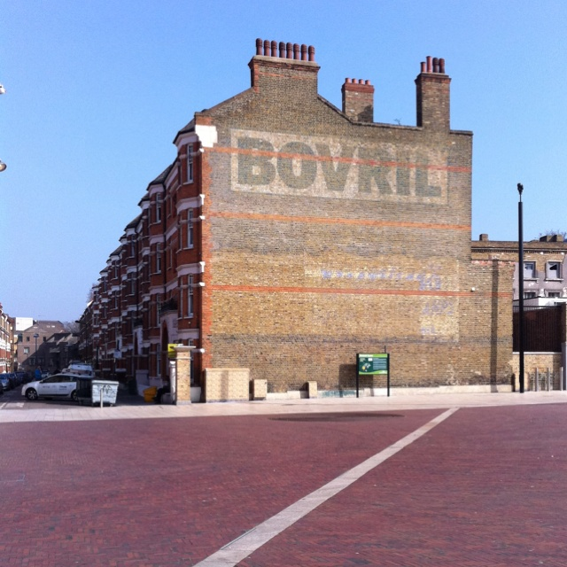 Ghost sign on Windrush Square Brixton