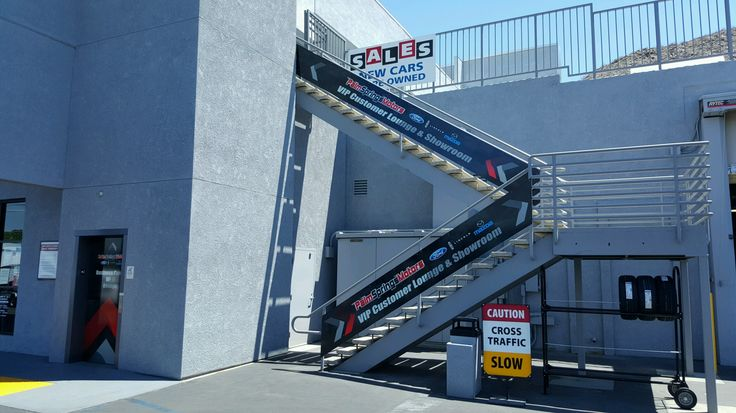 Exterior stairway branding at Palm Springs Motors in Palm Springs, CA. Visit their site to see more branding inside and out! Give us a call more info about branding 760-935-3600. #ExteriorBranding #CarDealership #PalmSprings #CoachellaValley