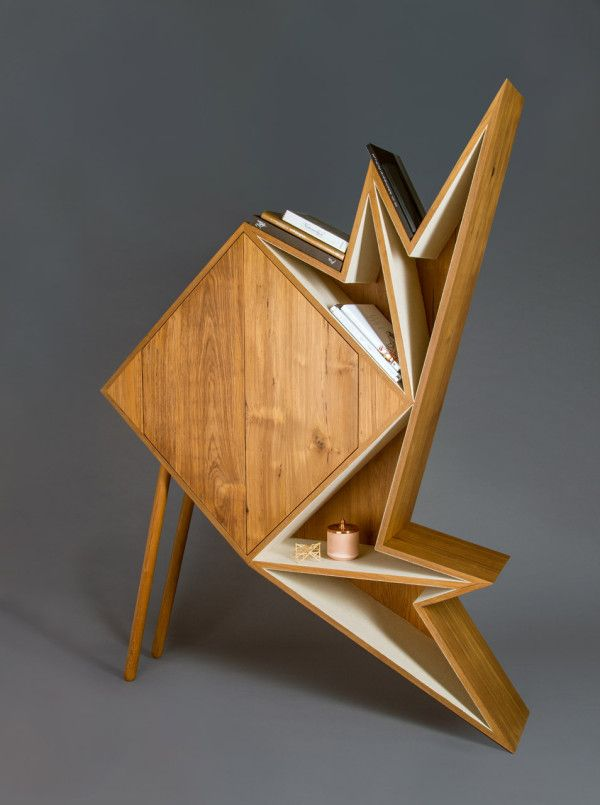 Oru Cabinet - Dubai-based product designer Aljoud Lootah created a collection of geometric furniture and objects that aim to explore form and function. The dramatic angles appear to almost be folded, like origami, which is where the collection gets its name – The Oru Series.