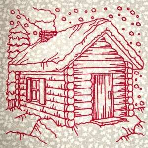 "This free embroidery design is called ""Christmas Cabin""."