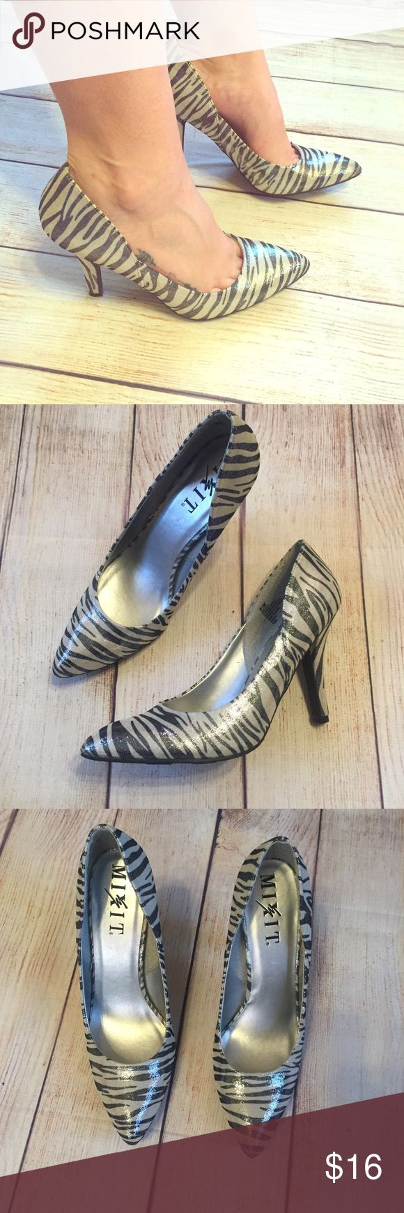 Zebra heels Zebra heels. Material has a shiny metallic effect to it. Never worn outside. Medium height heels. Feel free to ask for more photos, etc. mixit Shoes Heels