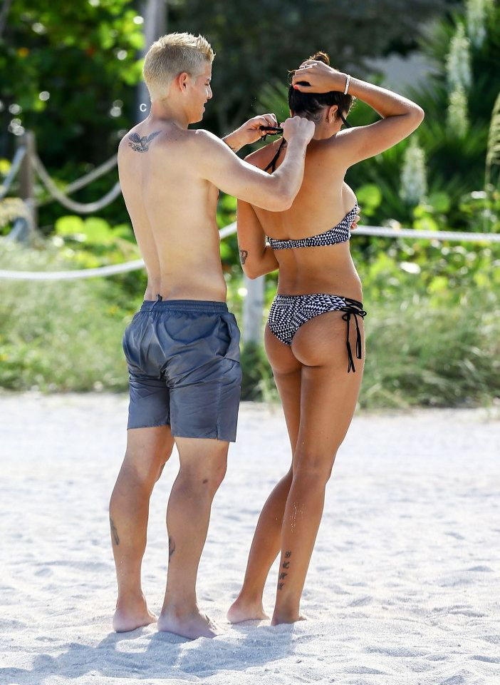 James Rodriguez helping his wife with her bathing suit. Miami 29.6.16
